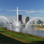 River Water Fountain And Cityscape Skyline Of Dayton,ohio, Morning